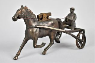 A Novelty Lighter In the Form of a Bronze Effect Trotting Horse and Sulky, One Wheel AF (We are