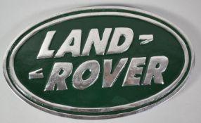A Reproduction Aluminum Oval Land Rover Plaque, 30cm wide