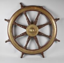 A Vintage Brass Mounted Ships Wheel, Inscribed with the War Department Crows Foot and Numbered