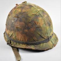An American Type 1 Steel Helmet with Camouflage Cover