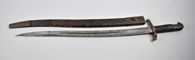 A British 1856 Pattern Bayonet, the Blade inscribed for Reilly with Leather Scabbard, Reilly