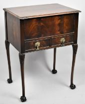 A Mahogany Lift Top Sewing Box with Two Base Drawers on Cabriole Supports with Claw and Ball Feet,