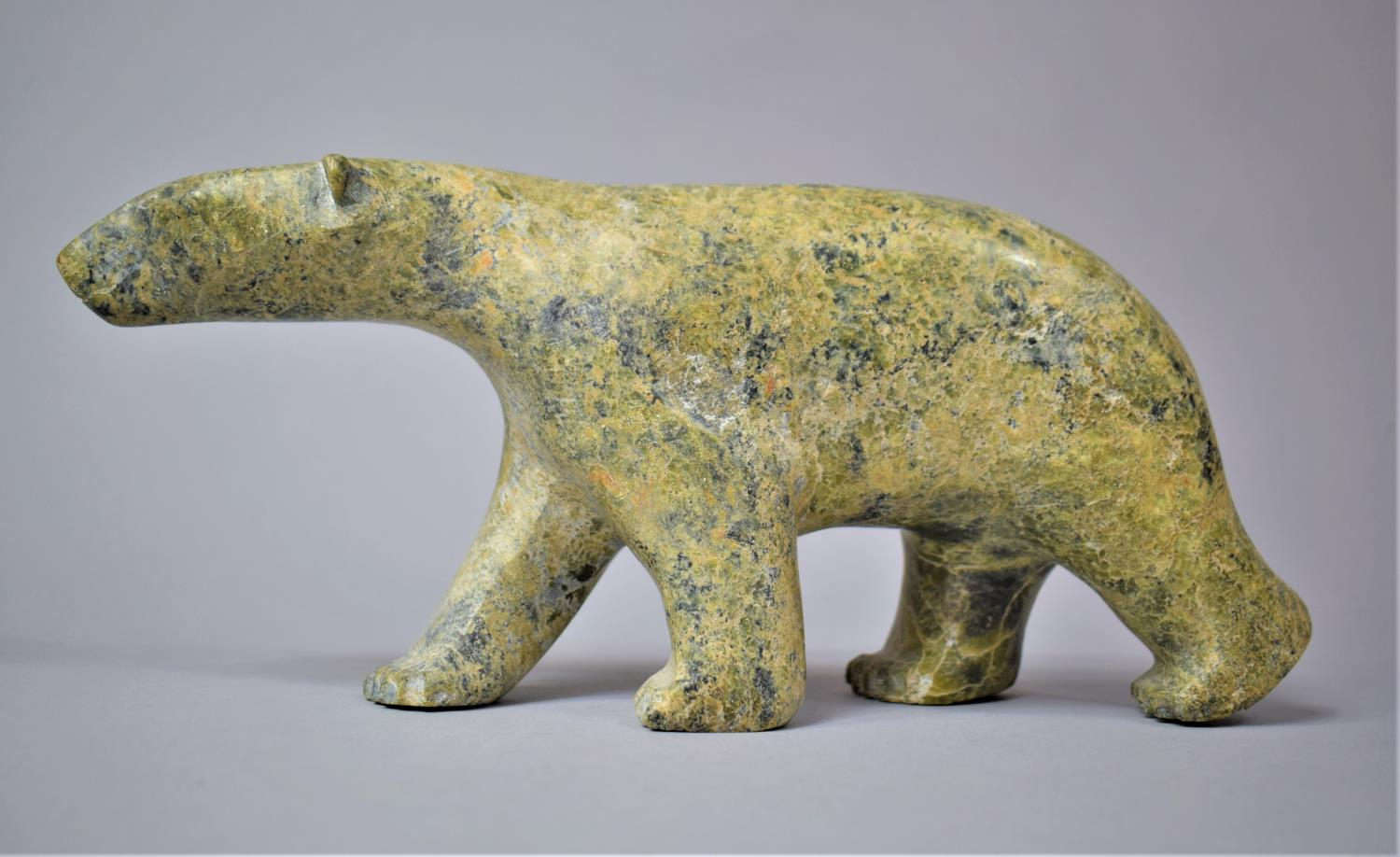 A Large Carved Green Stone Inuk Carving of a Walking Polar Bear,32cm Long