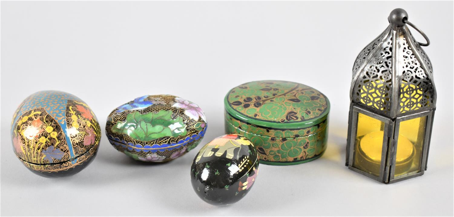 An Enamelled Pierced Brass Oriental Ovoid Lidded Box, Two Lacquered Papier Mache Boxes and a