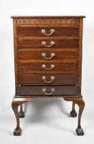 An Edwardian Mahogany Six Drawer Music Chest on Short Cabriole Supports with Claw and Ball Feet,