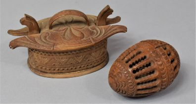 A Carved and Pierced Treen Box in the Form of an Egg Together with a Carved Wooden Lidded Oval Box