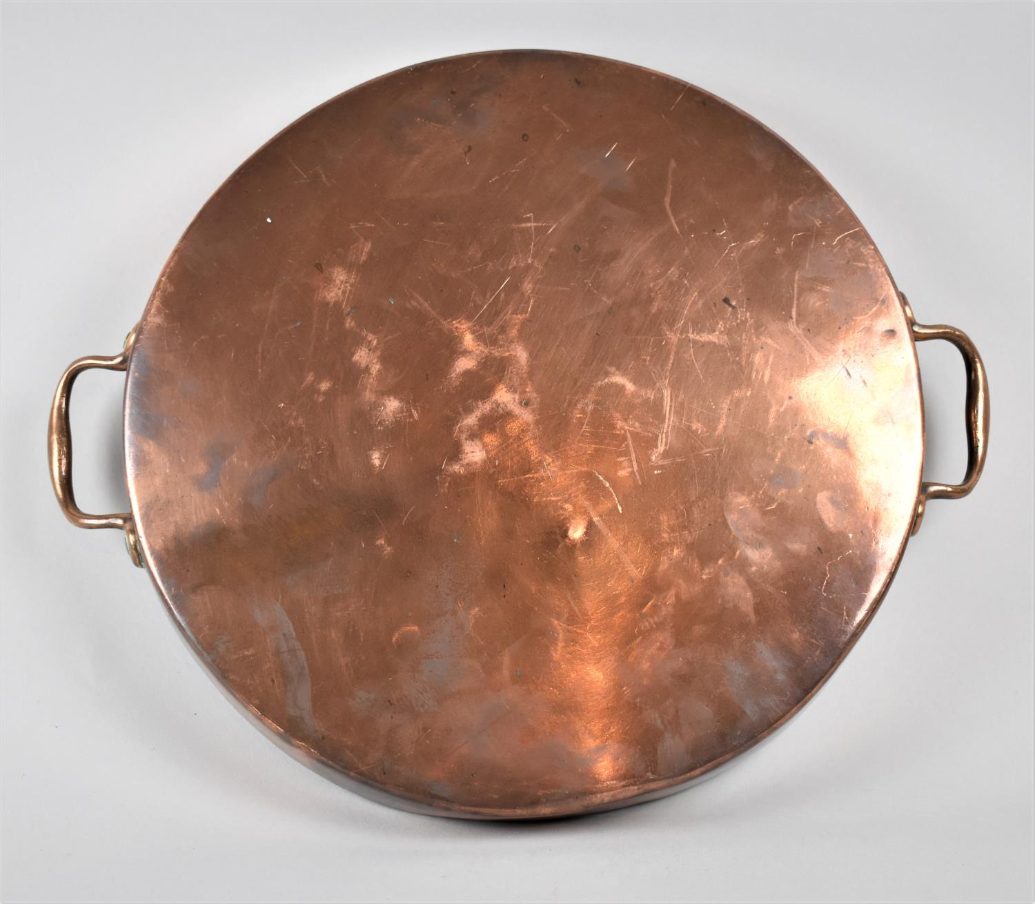A Victorian Copper Saucepan Lid with Two Handles, 35.5cm Diameter