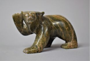 A Canadian Green Stone Inuk Carving of a Bear Cub with Raised Paw, 12cm Long