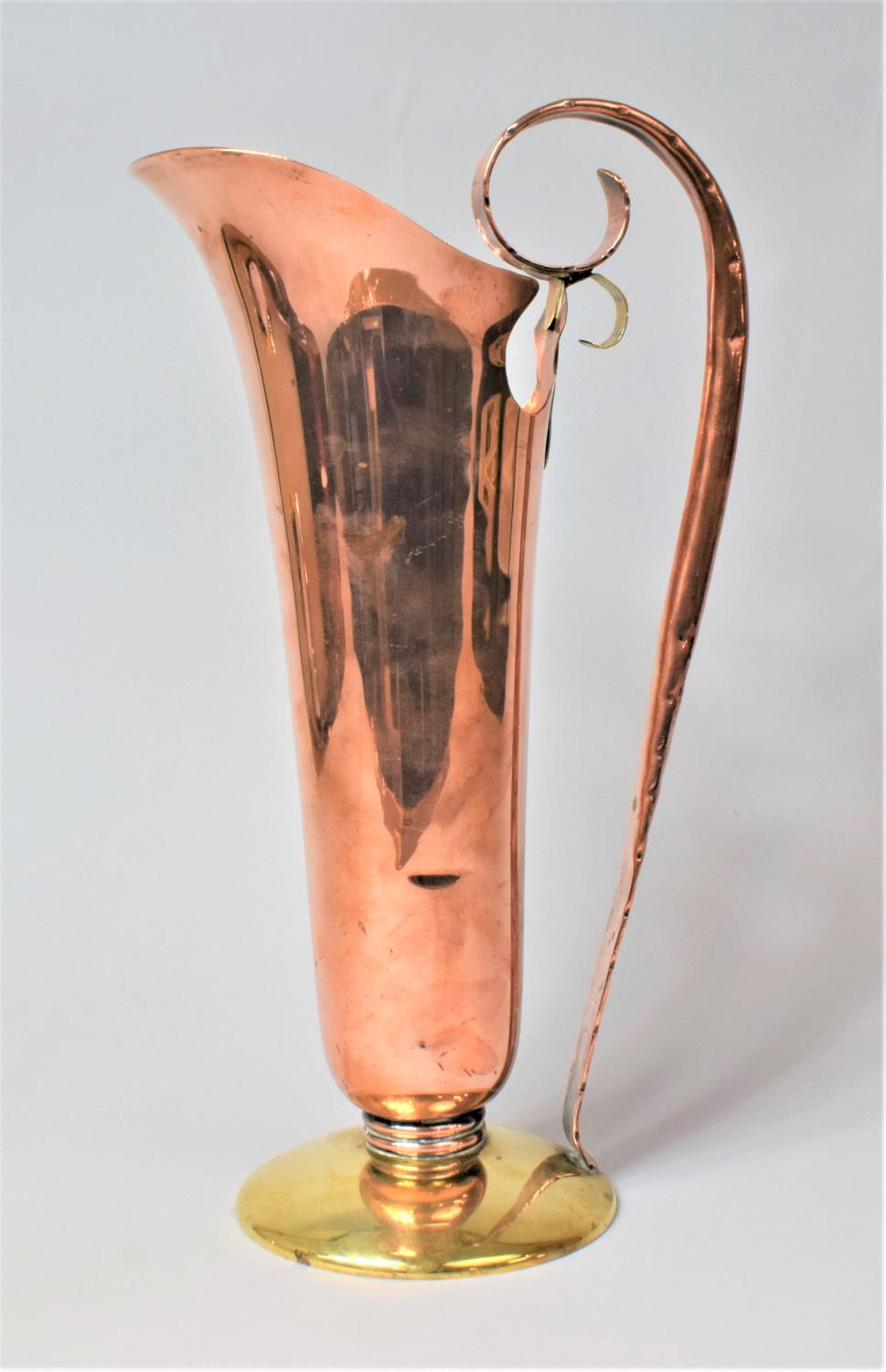 An Arts and Crafts Style Copper and Brass Ewer, 37cm high