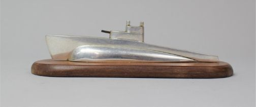 A Mid 20th Century Desk Top Aluminium Novelty Paperweight In the Form of a Submarine, Set on Oval