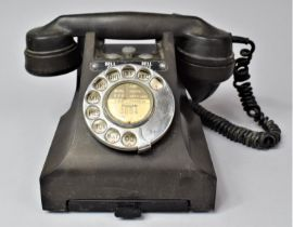 A Vintage Bakelite Telephone with Base Drawer