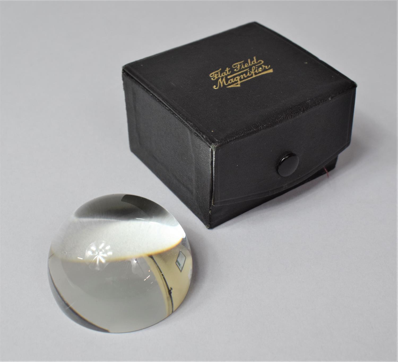 A Cased Flat Field Magnifier, 5.5cm Diameter