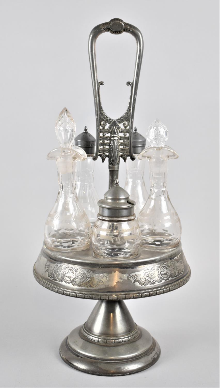 A Wilcox Meriden Silver Plated Five Bottle Circular Cruet, 1878 Patent, Number 3513, 43cm high