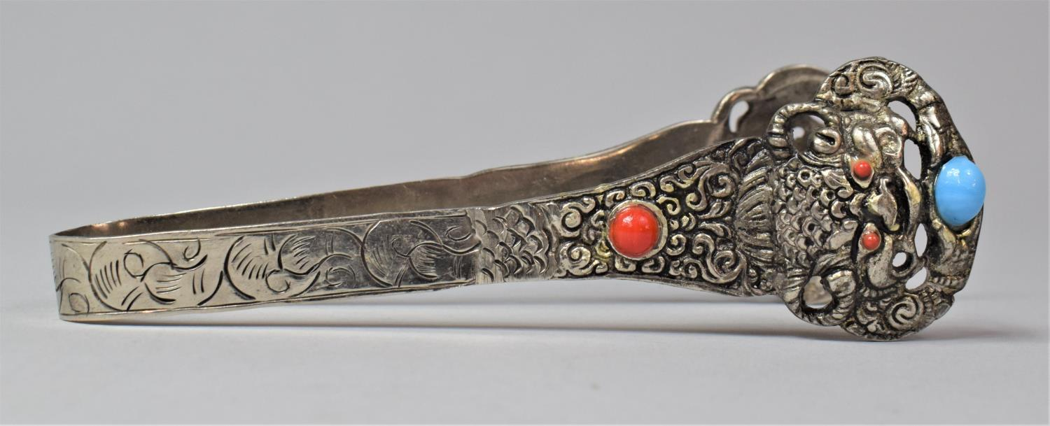 A Chinese White Metal Lion Mask Tongs with Coloured Cabochon, 15cm Long