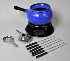 A Boxed New and Unused Fondue Set