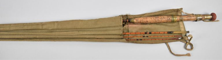 A Vintage Split Cane Three Piece Fly Rod with Two Ends in Canvas Bag