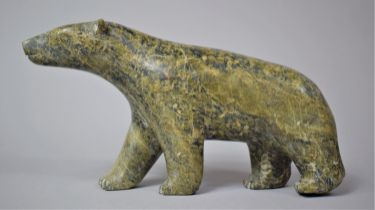 A Large Carved Green Stone Study of a Polar Bear, 23cm Long