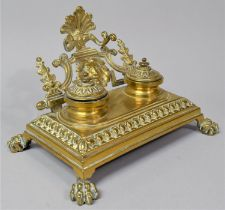 A French Brass Desktop Penrest and Two Bottle Inkstand on Four Claw Feet, 24cm Wide