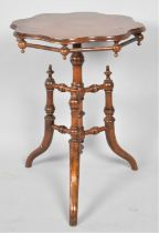 An Oriental Shaped Circular Topped Occasional Table on Tripod Base with Turned Stretchers, 49cm