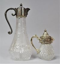 A Silver Plate Topped Mask Head Claret Jug and a Smaller Example with Lion Mask Pourer, Tallest 28cm