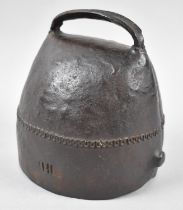 A Handworked and Riveted Cowbell Stamped IHL, 14cm high