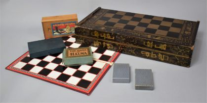 An Early 20th Century Lacquered Wooden Games Box with Chinoiserie Decoration, the Outer Surface with