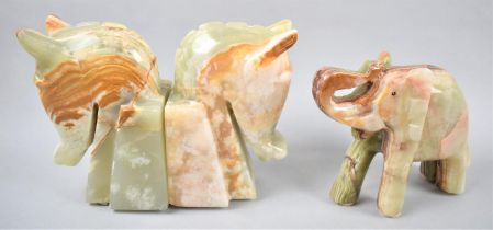 A Pair of Onyx Horseheads Bookends and a Carved Onyx Elephant with Trunk in Salute, Bookends 16cm