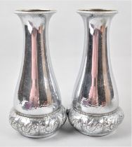 A Pair of Pressed Metal Silver Plated Vases, 26cm high
