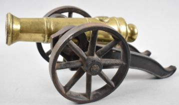 A Heavy Cast Iron and Brass Signal Cannon, 33cm Long