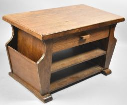 A Mid 20th Century Oak Rectangular Topped Coffee Table with Side Magazine Slots and Single Long