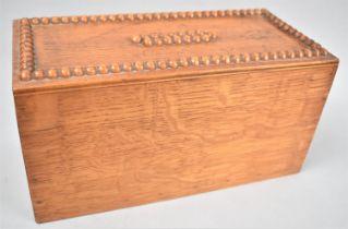 An Edwardian oak Rectangular Ballot Box with Carved Top and Emptying Door Under, 25cmsx12cmsx13cms