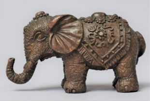 A Small Cast Bronze Study of an Indian Elephant with Trunk in Salute, 6cm Long