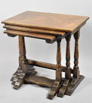 A Mid 20th Century Oak Nest of Three Tables with Turned Supports, The Largest 58cm wide