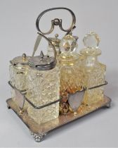 A Late Victorian/Edwardian Six Bottle Silver Plate and Glass Cruet with Shield Mount Inscribed J