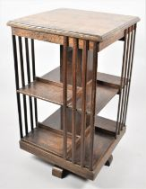 An Edwardian Oak Revolving Bookcase, One Side Lath AF, 47cms Square and 79cms High