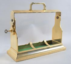 A Modern Brass Three Bottle Tantalus Frame, with Key, 34cms Wide