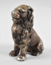 An Early 20th Century Cast Iron Novelty Money Box in the Form of a Seated Lion, 12.5cms High