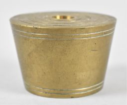 A Graduated Set of Eight Tapering Circular Brass Weights, 6.75cm Diameter