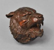 A Carved Wooden Netsuke in the Form of a Snarling Tiger, 5cm high