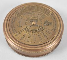 A Reproduction Cylindrical Compass with Lid Engraved with a 100 Year Calendar, 1957-2056, 7.5cms