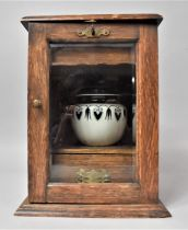 An Edwardian Oak Desktop Smoker's Cabinet with Glazed Door to Fitted Interior, Having Drawers Top