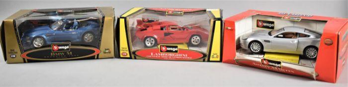 Three Boxed Burago Diecast Cars, Aston Martin, Lamborghini and BMW