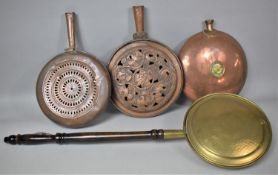 A Collection of Three Copper and One Brass Bed Pans