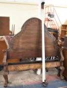A Mahogany Double Bed Frame with Arched Headboard and Scrolled Footboard, Claw and Ball Front