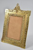 A French Bronze Easel Back Photo Frame with Horned Devil Finial, Stamped Back, 26cm High and 17cm