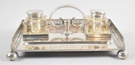 A Late Victorian/Edwardian Silver Plated Desk Top Ink Stand with Two Glass Bottles, Pen well and