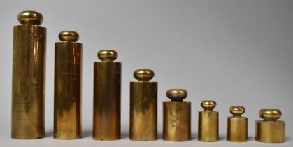 A Graduated Set of Eight Brass Cylindrical Weights, The Bases Stamped GWR and the Tallest 17cms High