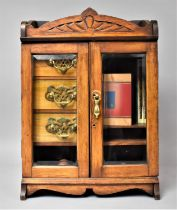 A Late Victorian/Edwardian Table Top Oak Smokers Cabinet with Glazed Doors to Fitted Interior Having