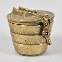 A Set of Four Cylindrical Tapering Graduated Brass Weights in Container with Hinged Lid, 5cms