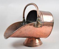 A Late Victorian Copper Helmet Shaped Coal Scuttle, 43cm Long